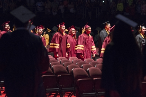 Newly graduated students prepare to take their seats during the Clark County School District's summer commencement ceremony at Orleans Arena in Las Vegas, Tuesday, Aug. 18, 2015. (Jason Ogul ...