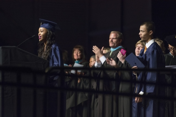 Shadow Ridge High School graduate, Antania Varra sings the National Anthem during the Clark County School District's summer commencement ceremony at Orleans Arena in Las Vegas, Tuesday, Aug. ...