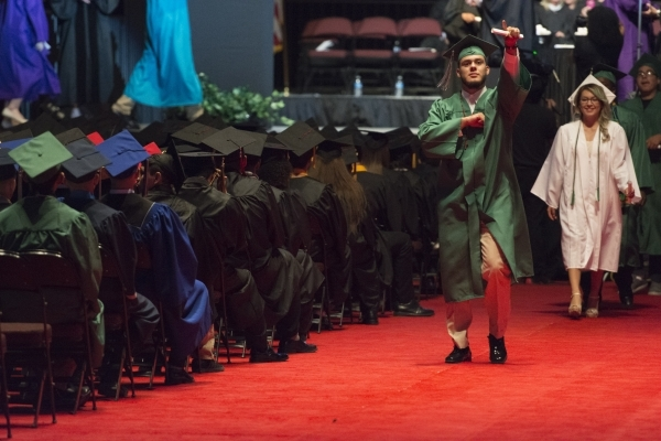 Newly graduated students collect their diploma during the Clark County School District's summer commencement ceremony at Orleans Arena in Las Vegas, Tuesday, Aug. 18, 2015. (Jason Ogulnik/La ...
