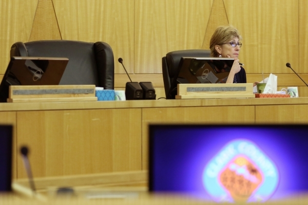 The empty seat of former Commissioner Tom Collins is shown next to Chris Giunchigliani during a meeting of the Clark County Commission on Tuesday. Collins tendered his resignation Aug. 10, apparen ...