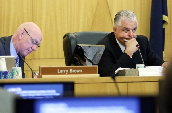 Vice Chairman Larry Brown, left, and Chairman Steve Sisolak participate in a meeting of the Clark County Commission on Tuesday. A public hearing on the More Cops sales tax increase was scheduled S ...