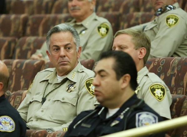 Clark County Sheriff Joe Lombardo, left, attends the Clark County Commission meeting Tuesday. A public hearing on the More Cops sales tax increase was scheduled Sept. 1. RONDA CHURCHILL/LAS VEGAS  ...