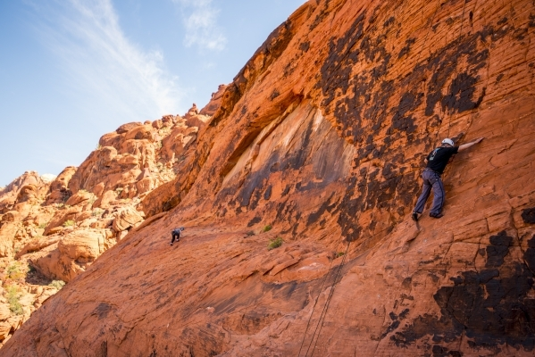 Climbers ascends up a cliff while rock climbing at Red Rock Canyon in Las Vegas on Tuesday, Aug. 18, 2015. (Joshua Dahl/Las Vegas Review-Journal)