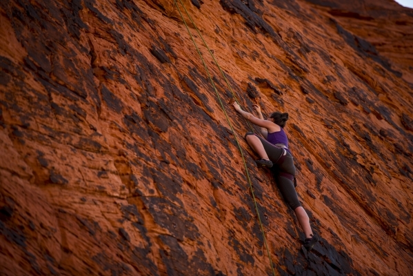 A climber ascends up a cliff while rock climbing at Red Rock Canyon in Las Vegas on Tuesday, Aug. 18, 2015. (Joshua Dahl/Las Vegas Review-Journal)