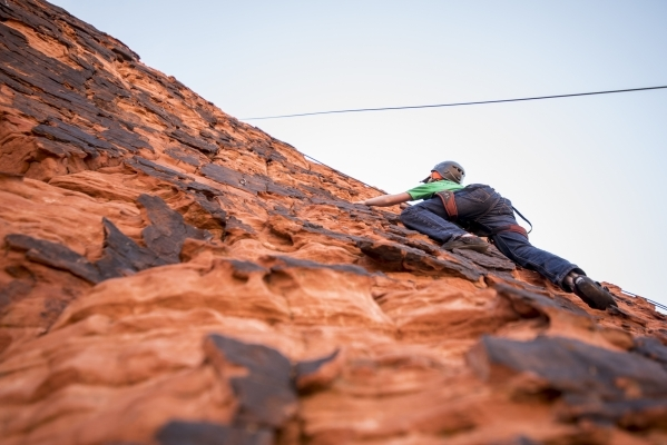Thomas Gessaro, 15, ascends up a cliff while rock climbing at Red Rock Canyon in Las Vegas on Tuesday, Aug. 18, 2015. (Joshua Dahl/Las Vegas Review-Journal)