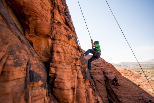 Thomas Gessaro, 15, descends down a cliff while rock climbing at Red Rock Canyon in Las Vegas on Tuesday, Aug. 18, 2015. (Joshua Dahl/Las Vegas Review-Journal)