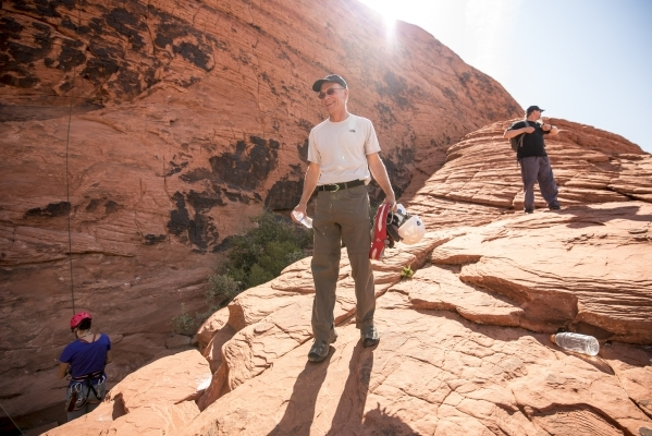 Steve Ellis, Bureau of Land Management deputy operations director, holds gear after rock climbing at Red Rock Canyon in Las Vegas on Tuesday, Aug. 18, 2015. (Joshua Dahl/Las Vegas Review-Journal)