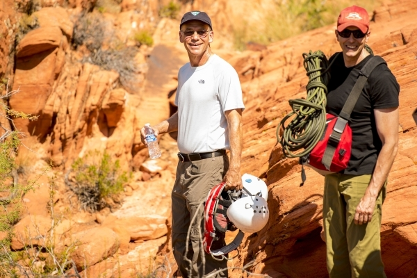 Steve Ellis, Bureau of Land Management deputy operations director, is followed by Mike Tupper, Bureau of Land Management deputy assistant director of resources & planning, after rock climbing  ...