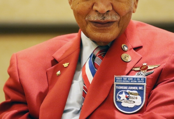 "Ret. Lt. Col. Robert ""Bob"" Ashby wears a Tuskegee Airmen patch along with several pins during the Tuskegee Airmen Inc. 44th national convention at JW Marriott Wednesday, Aug. 19, 2015, i ..."