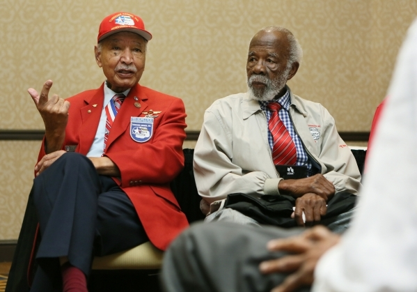"Ret. Lt. Col. Robert ""Bob"" Ashby, left, speaks about his time in the Army Air Corps and sits near Ted Lumpkin during the Tuskegee Airmen Inc. 44th national convention at JW Marriott Wedn ..."