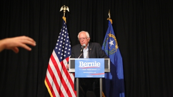 Democratic presidential candidate, Sen. Bernie Sanders, I -Vt., listens to a question from a reporter while speaking with news media following a speech at an AFL-CIO conference at the Luxor hotel- ...