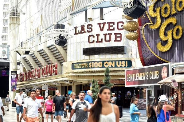 Tourists walk along the Fremont Street Experience in front of the Las Vegas Club hotel-casino on Monday, Aug. 17, 2015, in Las Vegas. The the 86-year-old sports-themed downtown property was recent ...
