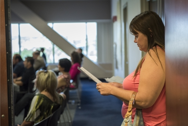 Concerned parent Kristi Barile, reads over notes during a pubic workshop about Nevada's upcoming new Education Savings Account held at the State Treasurer's office inside the Grant Saw ...