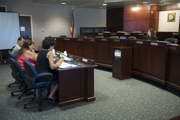 Deputy Treasurer Linda J. English, right, listens to concerned parents voice their opinion on Nevada's upcoming new Education Savings Account during a pubic workshop held at the State Treasu ...