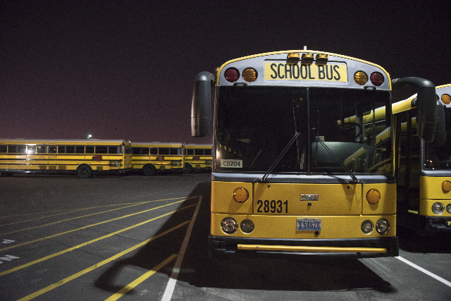 The Cheyenne Avenue school bus depot  in North Las Vegas is shown at 5 a.m. during Clark County School District's first day of classes, Monday, Aug. 24, 2015. (Jason Ogulnik/Las Vegas Review ...
