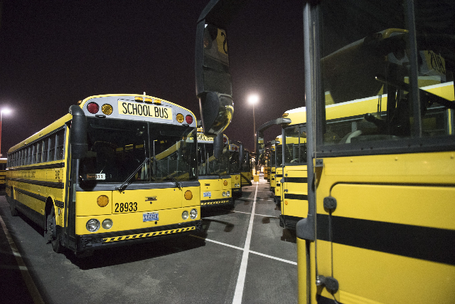 The Cheyenne Ave. school bus depot  in North Las Vegas is shown at 5 a.m. during Clark County School District's first day of classes, Monday, Aug. 24, 2015. (Jason Ogulnik/Las Vegas Review-J ...