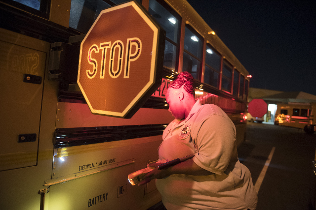 Clark County School bus driver Laura Hicks inspects her bus before leaving the Cheyenne Avenue school bus depot in North Las Vegas at 5 a.m. during Clark County School District's first day o ...