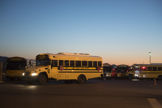 A Clark County School District bus leaves the Cheyenne Avenue depot in North Las Vegas at 5 a.m. during Clark County School District's first day of classes, Monday, Aug. 24, 2015. (Jason Ogu ...