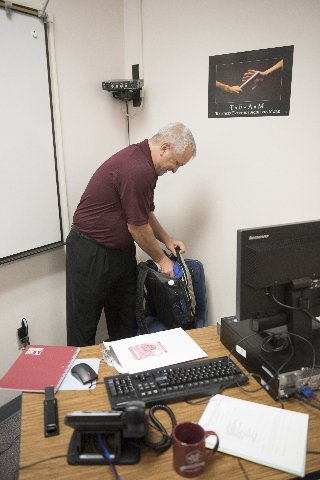 Algebra 2 teacher Michael Loeffelholz unpacks his bags before his first class at Cimarron-Memorial High School during Clark County School District's first day of classes in Las Vegas, Monday ...