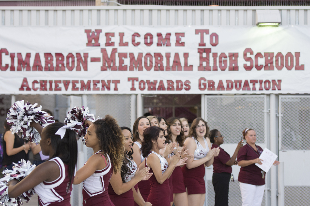 Cheerleaders greet students at Cimarron-Memorial High School during Clark County School District's first day of classes in Las Vegas, Monday, Aug. 24, 2015. (Jason Ogulnik/Las Vegas Review-J ...