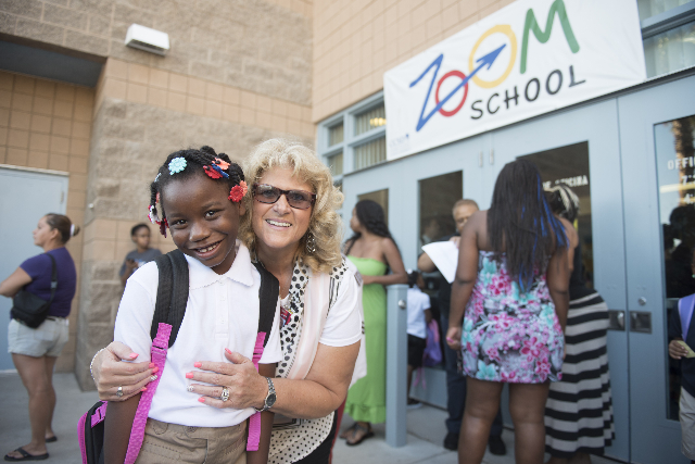 Delilah Everage, second grade, left, poses with principal Belinda Jones  prior to starting
