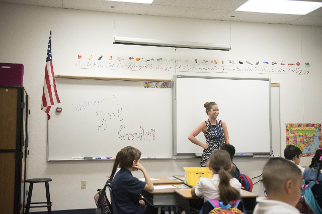 3rd grade teacher, Ashley Lucas introduces herself to her class at Cortez Elementary School during Clark County School District's first day of classes in Las Vegas, Monday, Aug. 24, 2015. (J ...