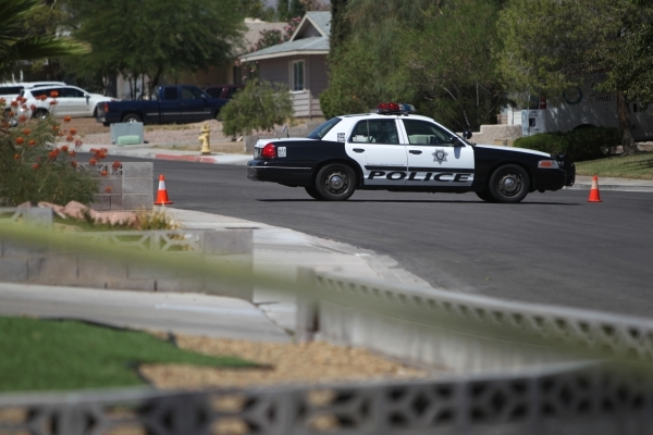 A police car blocks the are where a man was fatally shot during a confrontation with Metro on Sunday morning. ERIK VERDUZCO/LAS VEGAS REVIEW-JOURNAL Follow him