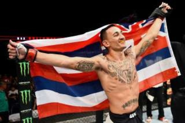 UFC featherweight contender Max Holloway rejoices after defeating Charles Oliveira by technical knockout in little more than a minute Sunday night at Saskatoon, Saskatchewan. COURTESY PHOTO