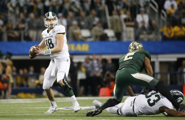 Michigan State senior quarterback Connor Cook looks to throw during last season's Cotton Bowl at AT&T Stadium in Arlington, Texas. The Spartans return 14 starters this season, but their  ...