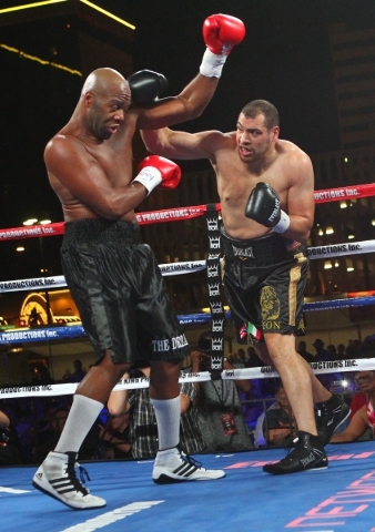 Trevor Bryan, left, blocks a punch from Derric Rossy during their NABF heavyweight title fight at the Downtown Las Vegas Events Center in Las Vegas on Friday, Aug. 28, 2015. Chase Stevens/Las Vega ...