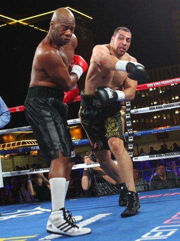 Trevor Bryan, left, takes a hard right from Derric Rossy during their NABF heavyweight title fight at the Downtown Las Vegas Events Center in Las Vegas on Friday, Aug. 28, 2015. Chase Stevens/Las  ...