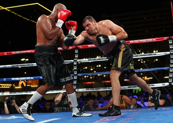 Trevor Bryan, left, blocks a hit from Derric Rossy during their NABF heavyweight title fight at the Downtown Las Vegas Events Center in Las Vegas on Friday, Aug. 28, 2015. Chase Stevens/Las Vegas  ...