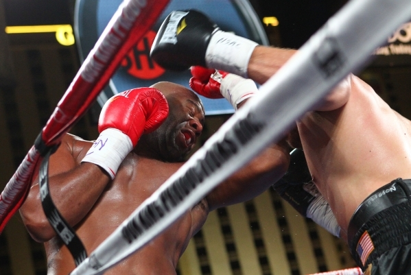 Trevor Bryan, left, trades punches with Derric Rossy during their NABF heavyweight title fight Friday at the Downtown Las Vegas Events Center. Bryan (16-0) won a 10-round unanimous decision. CHASE ...