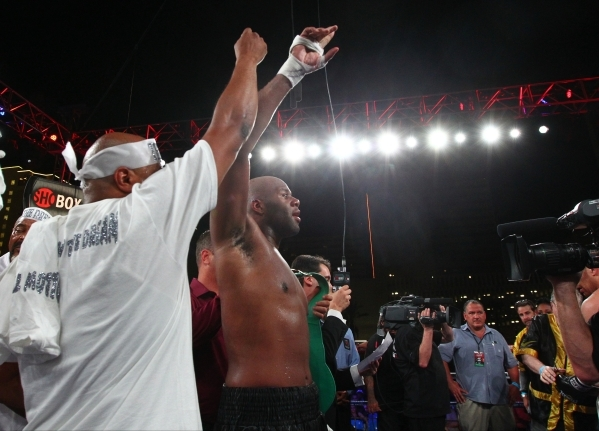 Trevor Bryan celebrates his victory against Derric Rossy, not pictured, in their NABF heavyweight title fight at the Downtown Las Vegas Events Center in Las Vegas on Friday, Aug. 28, 2015. Chase S ...