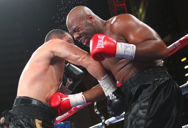 Derric Rossy, left, and Trevor Bryan trade blows during their NABF heavyweight title fight at the Downtown Las Vegas Events Center in Las Vegas on Friday, Aug. 28, 2015. Chase Stevens/Las Vegas Re ...