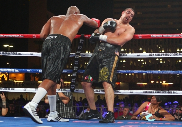 Trevor Bryan, left, keeps Derric Rossy against the ropes during their NABF heavyweight title fight at the Downtown Las Vegas Events Center in Las Vegas on Friday, Aug. 28, 2015. Chase Stevens/Las  ...