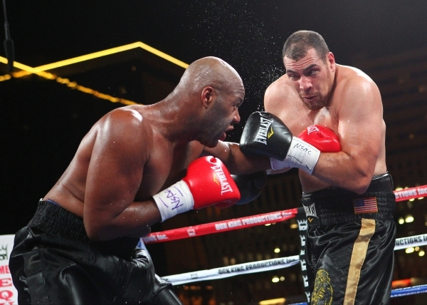 Trevor Bryan, left, lands a punch against Derric Rossy during their NABF heavyweight title fight Friday at the Downtown Las Vegas Events Center. Bryan (16-0) won a 10-round unanimous decision. CHA ...