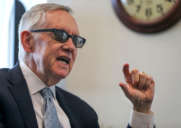 U.S. Sen. Harry Reid, D-Nev., answers media questions in his office in Reno earlier  this month. Reid says NV Energy needs to embrace the new solar technology. Cathleen Allison/Las Vegas Review-Jo ...