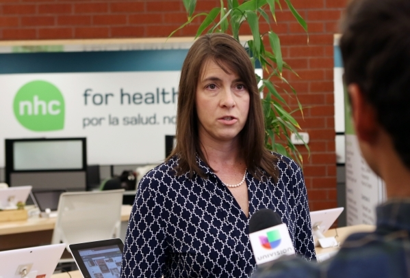 The Nevada Health CO-OP member and Board Director, Stacey Hatfield, left, addresses the media at the co-op's walk-in center on 3900 Meadows Ln. Wednesday, Aug. 26, 2015. A nonprofit insurer  ...
