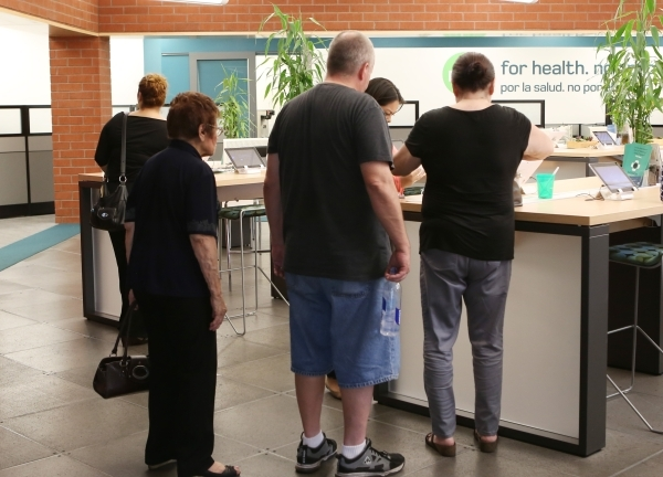 People are seen being assisted by the Nevada Health CO-OP crew member at the co-op's walk-in center on 3900 Meadows Ln. Wednesday, Aug. 26, 2015. A nonprofit insurer created by the Affordabl ...