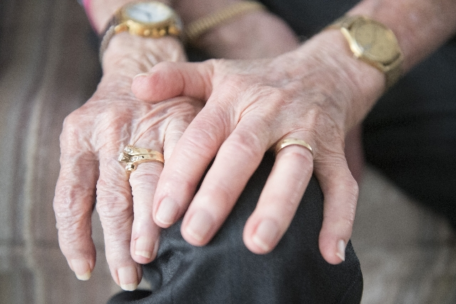 "William Kenneth ""Ken"" Boswell, right, and Ruth Geraldine ""Jerry"" Boswell hold hands while talking about their life together at their Henderson home on Saturday, Aug. 29, 2015.  ..."