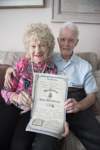 "William Kenneth ""Ken"" Boswell, right, and Ruth Geraldine ""Jerry"" Boswell show their wedding certificate two days prior to their 75th wedding anniversary at their Henderson home ..."