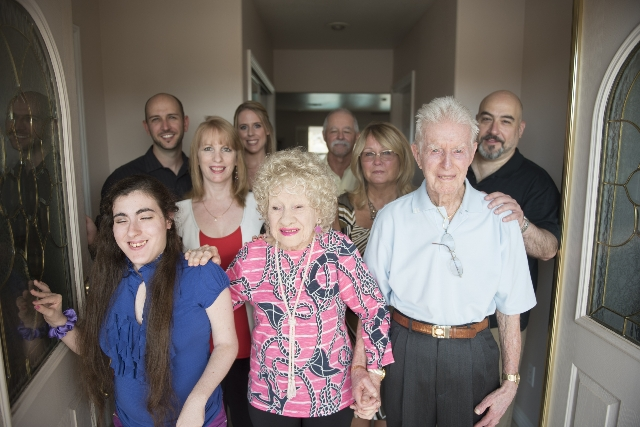 "Ruth Geraldine ""Jerry"" Boswell, second from left, and William Kenneth ""Ken"" Boswell, third from left pose for a photo with their family two days before to their 75th wedding an ..."