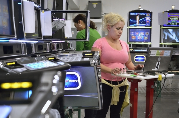 Assembler Perla LaCroix tests a game on the assembly line at Konami Gaming in Las Vegas on Friday, Aug. 28, 2015. (Bill Hughes/Las Vegas Review-Journal)