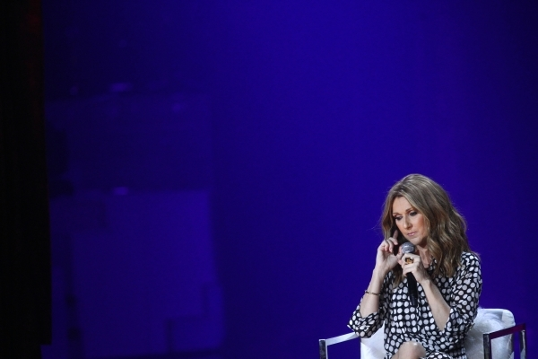 Celine Dion listens to a question during a press conference before her first performance in more than a year at the Colosseum at Caesars Palace hotel-casino in Las Vegas on Thursday, Aug. 27, 2015 ...