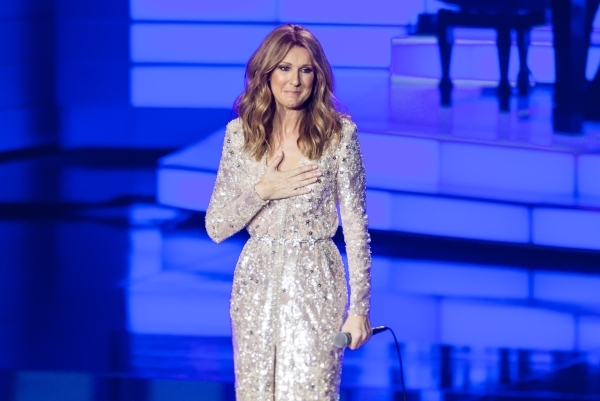 Celine Dion pauses as she receives a standing ovation from the audience at the Colosseum at Caesars Palace hotel-casino, following a year-long hiatus, in Las Vegas on Thursday, Aug. 27, 2015. Chas ...