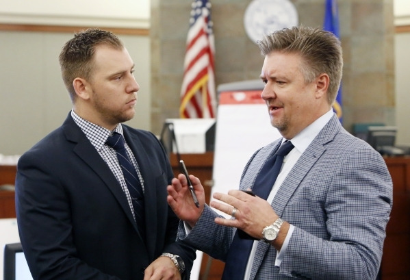 A former UNLV, Bishop Gorman player Beau Orth, left, listens to his attorney Dennis Prince prior to the start of the trial at the Regional Justice Center in Las Vegas Friday, Aug. 28, 2015. Orth i ...