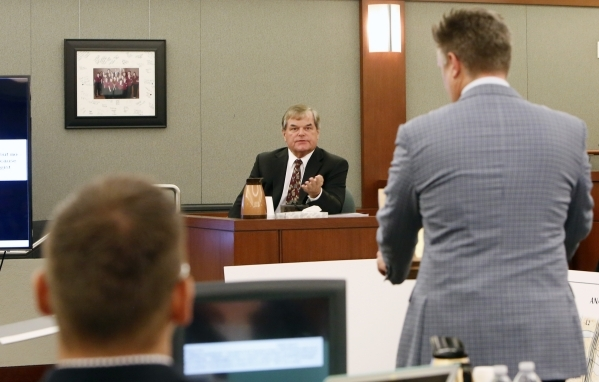 Dr. Albert Capanna, center, speaks during cross examination at his trial as Beau Orth, left, and his Attorney Dennis Prince, right, look on at the Regional Justice Center in Las Vegas Friday, Aug. ...