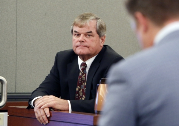 Dr. Albert Capanna, left, listens to Attorney Dennis Prince during cross examination at his trial at the Regional Justice Center in Las Vegas Friday, Aug. 28, 2015. Capanna is sued by A former UNL ...