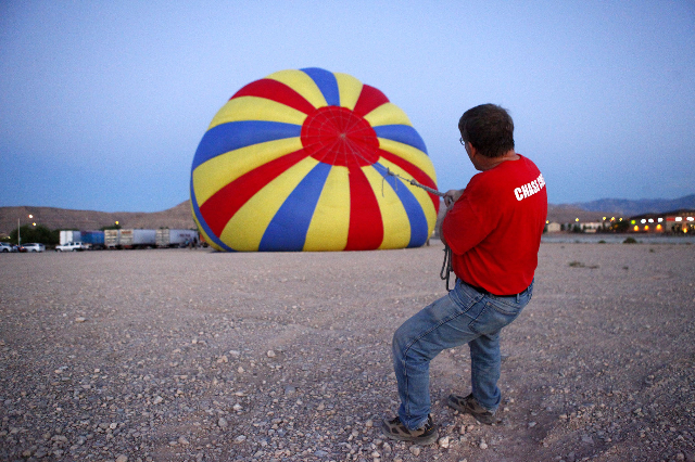 Douglas Pritchard, part of the Chase Crew for Vegas Balloon Rides, helps inflate a hot air balloon Friday morning, August 28, 2015. (Michael Quine/Las Vegas Review-Journal) Follow @Vegas88s